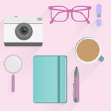 Office desk table flat design. Top view Eps10 vector template. Office desk table with photo camera, glasses, flash drive, pen, notebooks, magnifying glass, and Royalty Free Stock Photography