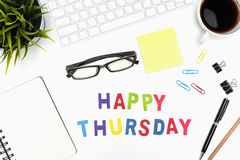 Office desk table with happy thursday word. Office desk table with supply, pen, pencil, notebook, computer, eye glasses, sticky note, cup of coffee and happy stock image