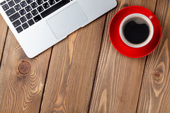 Office desk table with laptop computer and coffee cup Royalty Free Stock Photo