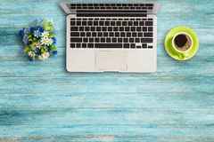 Office desk table with laptop computer on wooden table Royalty Free Stock Images