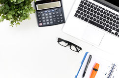 Office desk table with laptop, office supplies top view royalty free stock photos