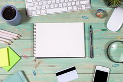 Office desk table with laptop. Online shopping concept. Office desk table with laptop, pen and notebook. Top view with copy space. Online shopping concept Royalty Free Stock Photos