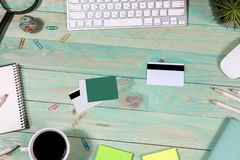 Office desk table with laptop. Online shopping concept. Office desk table with laptop, pen and notebook. Top view with copy space. Online shopping concept Royalty Free Stock Images