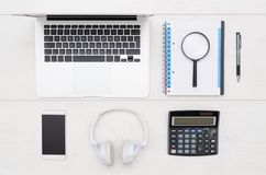 Office desk table with laptop, smartphone, and office supplies royalty free stock photography