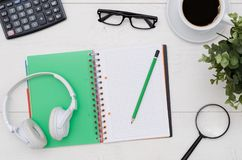 Office desk table layout with headphones and supplies Stock Photos