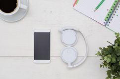 Office desk table layout with headphones and smartphone Stock Image