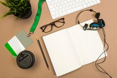 Office desk table with  notebook keyboard notebook badge  headphones coffee and glasses Mock up template . Top view stock photos