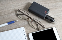 Office desk table with notebooks, pen, smartphone and eye glasse Stock Image