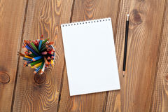 Office desk table with notepad and colorful pencils Stock Photo