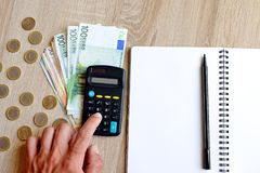 Office desk table with pen,notebook,calculator and money. Stock Photo