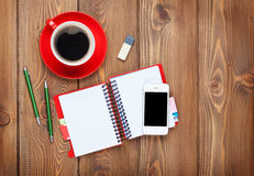 Office desk table with supplies and coffee cup Royalty Free Stock Images
