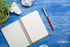 Office desk table with supplies and crumled paper. Top view. Copy space for text.  stock image
