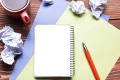 Office desk table with supplies and crumpled paper. Top view. Copy space for text Royalty Free Stock Photos