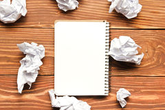 Office desk table with supplies and crumpled paper. Top view. Copy space for text.  stock images