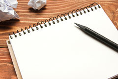 Office desk table with supplies and crumpled paper. Top view. Copy space for text Stock Image