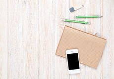 Office desk table with supplies and smartphone Stock Images