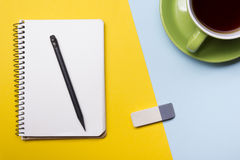 Office desk table with supplies top view. Notepad, pen and colorful paper. Copy space for text.  Royalty Free Stock Photos