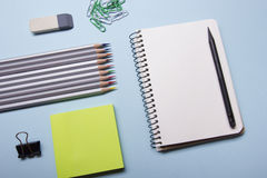 Office desk table with supplies top view. Notepad, pen and colorful paper. Copy space for text Stock Image