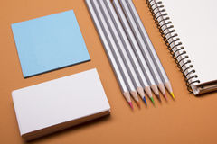 Office desk table with supplies top view. Notepad, pencil and blank business card colorful paper. Copy space for text Stock Photo