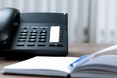 Office Desk with Telephone and Agenda. Telephone desk office desk business note pad phone landline phone Stock Images
