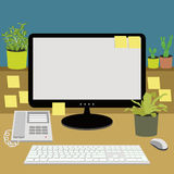 Office desk with telephone, computer, keyboard and plants Stock Photo