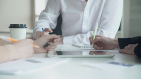 In the office at the desk three members make up plan for the project. stock footage