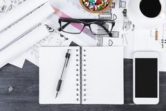 Office desk top with smartphone and notepad stock images