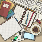 Office desk top view filled with various items Stock Image