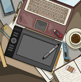 Office desk top view filled with various items Royalty Free Stock Image