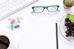 Office desk top view with keyboard, laptop eyeglasses,coffee cup. and book. Stock Image