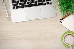 Office desk top view with lot of stuff. On wooden background Royalty Free Stock Image