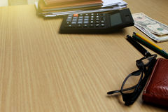 Office desk with US Dollars, smartphone with black screen, pen, stock image