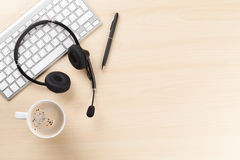 Free Office Desk With Headset And Pc Royalty Free Stock Photography - 67910377