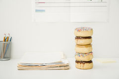 Office Desk With Stack Of Donuts Royalty Free Stock Image