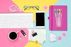 Office Desk Working Space Flat Lay. Top view photo of workspace with keyboard, notepad and coffee on pastel colored background. stock images