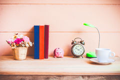 Office desk workplace with books and alarm clock on the wooden. Stock Image