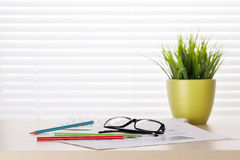 Office desk workplace with supplies and plant Stock Photo