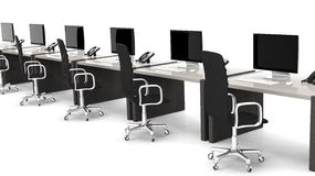 Office desks with equipment and black chairs Royalty Free Stock Photo