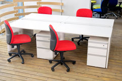 Office desks and red chairs cubicle set Stock Photography