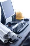 Office Desktop. A professional desktop of an Engineer with drawings computer. W/B adjusted for cool look Royalty Free Stock Image