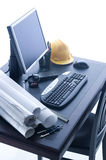 Office Desktop. A professional desktop of an Engineer with drawings computer Royalty Free Stock Photos