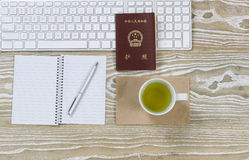 Office Desktop with China Passport and green tea Stock Photo