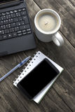 Office desktop with coffee, notepad and laptop. Stock Images