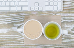Office Desktop with Coffee and Tea Drinks Royalty Free Stock Images