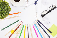 Office desktop with colorful items Royalty Free Stock Images