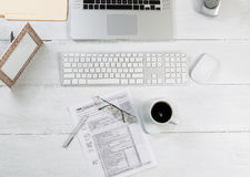 Office desktop with financial tax forms Royalty Free Stock Image