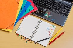 Office desktop with folders, laptop, opened notebook and pencils. Office desktop with folders, laptop, opened notebook, glasses and pencils Royalty Free Stock Photography