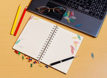 Office desktop with laptop, opened notebook and pencils. Office desktop with laptop, opened notebook and colorful pencils Stock Images