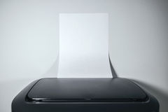 Office desktop laser printer with blank paper as copy space Stock Image