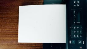 Office desktop laser printer printing single A4 letter page